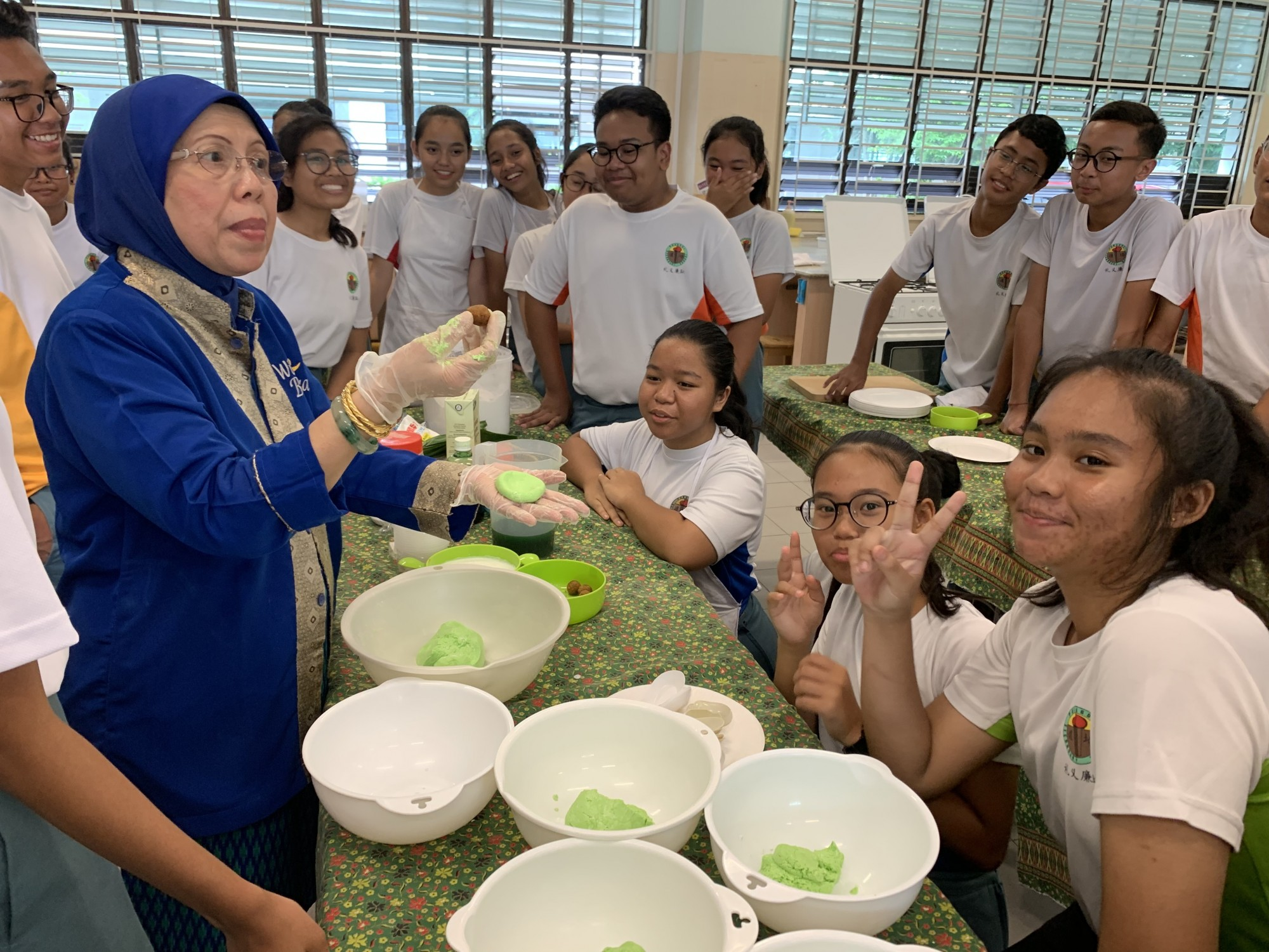 Students learning to make traditional food during MTL fortnight.JPG
