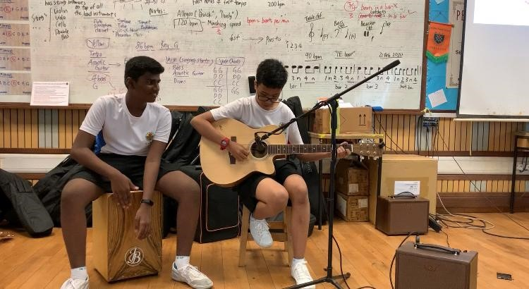 Students learn play guitar and compose music.jpg